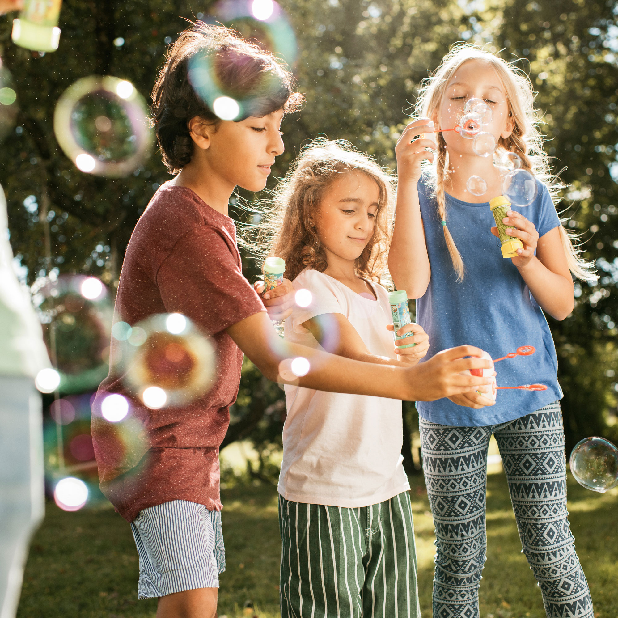 Children blowing soap bubbles.